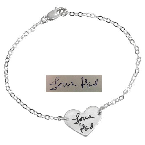 Custom silver handwriting heart bracelet, shown with original handwritten signature used to personalize it
