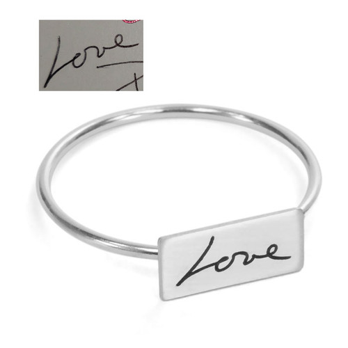 """Custom Rectangle Dainty Handwriting Ring, personalized with loved one's actual handwritten word, """"Love"""", shown with original handwriting, from the top on a white background"""