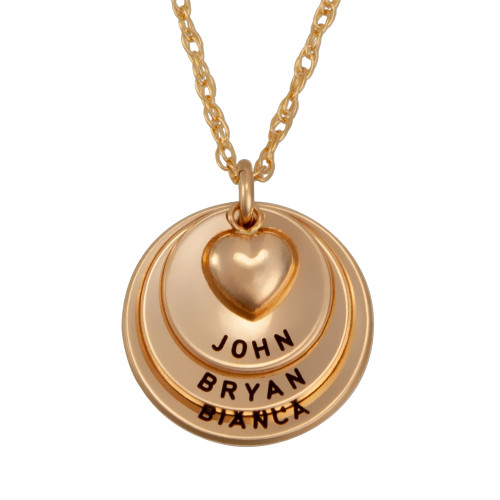 Custom gold curved discs with puffed heart, hand stamped with kids names, shown close up on white