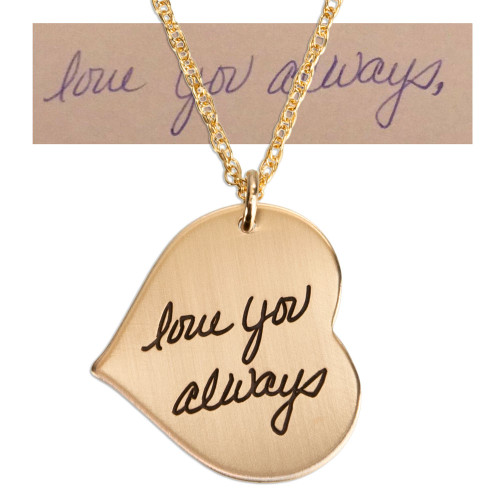 """Custom Gold heart necklace engraved with actual handwriting  saying, """"Love you always"""", showing gold chain on white background, with original handwritten note used to personalize it"""