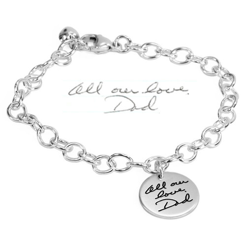 Custom Silver memorial Handwriting Bracelet with Dad's handwriting, shown with original handwritten note used to personalize it, on white