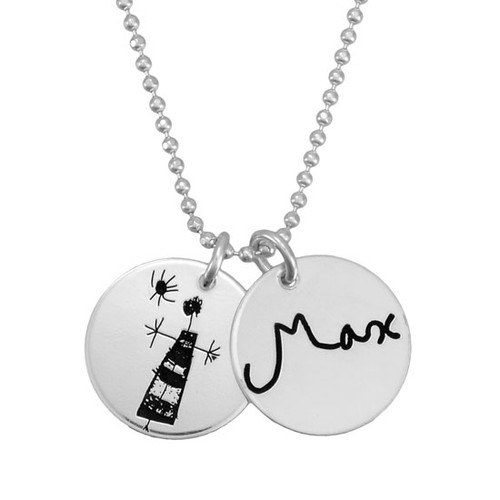 Custom silver handwriting jewelry charms personalized with child's signature and drawing, shown close up on white