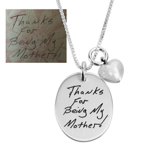Gift for Mom with custom silver Oval Handwriting/Artwork Charm, personalized with child's drawing and signature, shown close up on white