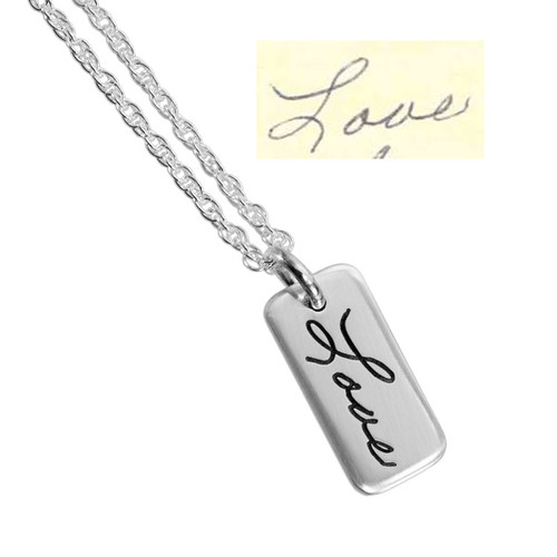 """Dainty Custom Silver Handwriting Tag necklace, personalized with handwritten """"Love"""", shown with original handwriting"""