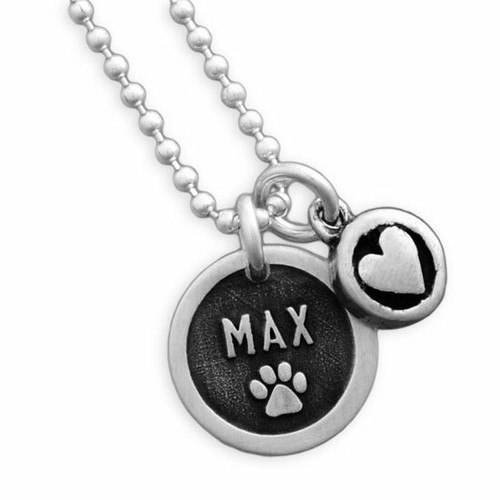 Custom Silver Etched Paw Disc Necklace, with dog's name, shown close up on white