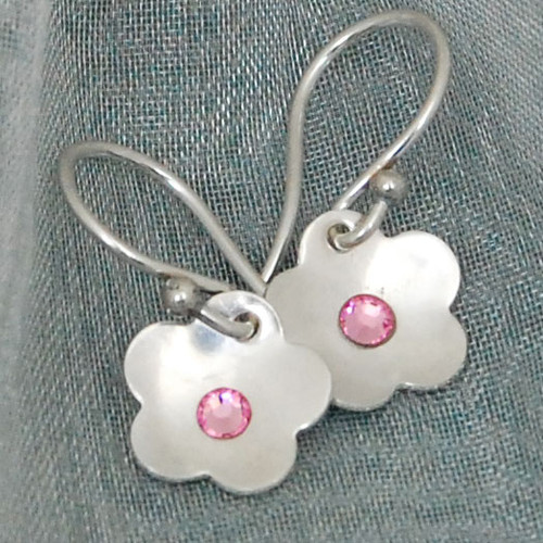 Custom sterling silver Flower Birthstone Earrings with pink birthstone, shown on green background