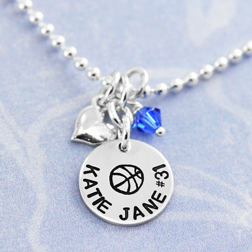 Silver Girls Disc with Heart and Birthstone, hand stamped with a flower and girl's name, shown with blue birthstone