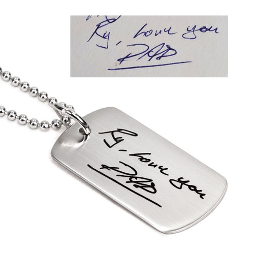 Custom silver dog tag memorial necklace with Dad's handwriting, with the original handwritten note used to create it, shown on white