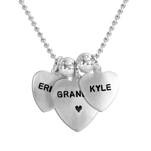 Grandma silver heart custom necklace, personalized with hand stamped kids' names, shown close up on white