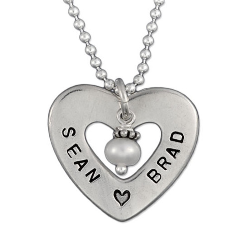 Close up of sterling silver Hand Stamped Heart of Love Necklace, showing personalization