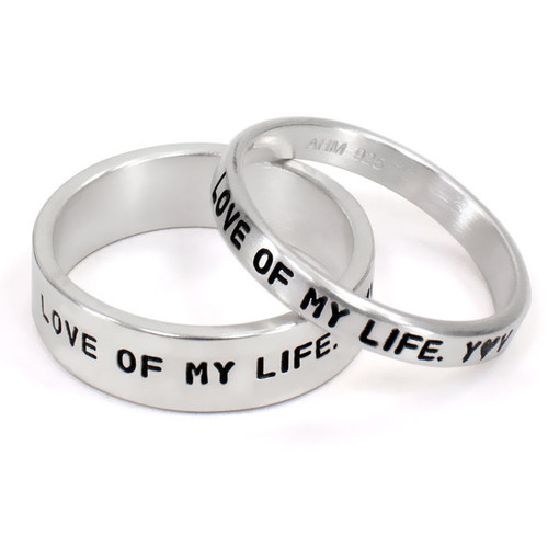 His and Her Personalized Ring Set, with silver rings stamped with your custom message, shown on white