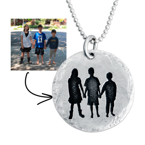 Sterling silver disc charm with etched silhouette of three kids