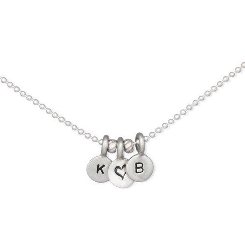 Our Tiniest Initials Necklace custom made with sterling silver hand stamped charms, shown close up