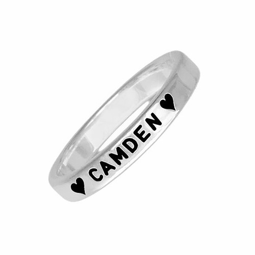 Hand stamped sterling silver stackable rings, personalized with child's name Camden and hearts, shown close up on white
