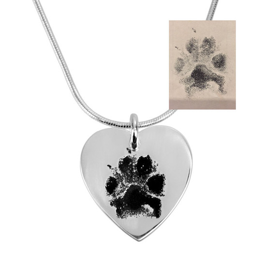 Custom silver heart necklace personalized with your pet's actual paw print, engraved on a sterling silver heart charm, shown close up on white