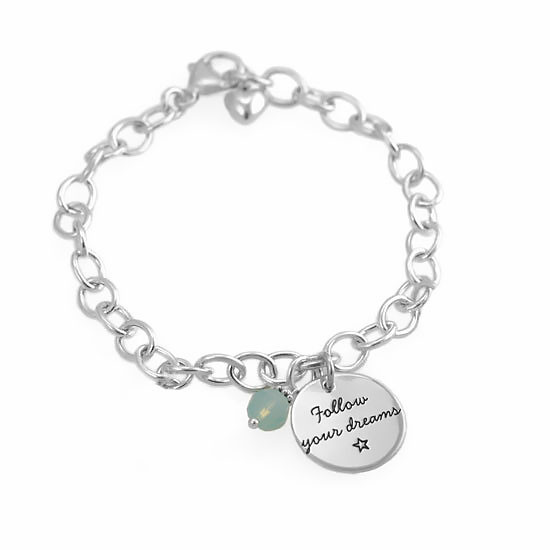 Custom Your Saying On A Bracelet in sterling silver, personalized with your message hand stamped on the charm, shown on white