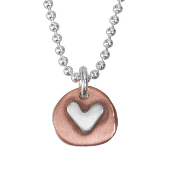hand made copper heart charm with silver heart, on a silver ball chain, shown close up on white