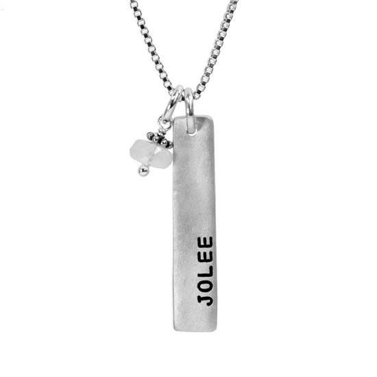 Hand stamped silver rectangle necklace with birthstone, personalized with the name Jolee, shown close up on white background