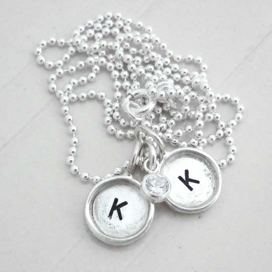 Custom mini round initial charms, handmade in sterling silver and personalized with hand stamped initials