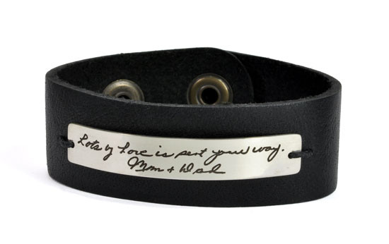 Signature handwriting leather bracelet with sterling silver plate, shown on white