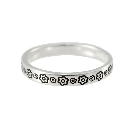 Stackable silver ring stamped with flowers