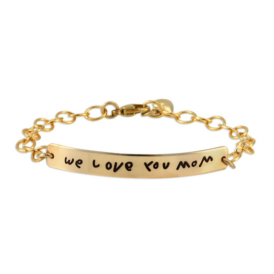Custom gold signature ID bracelet, personalized with child's handwritten note to mom, shown on white