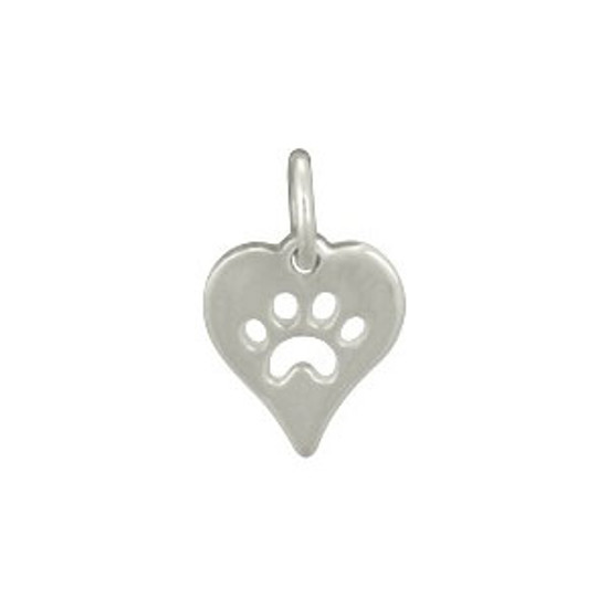 Silver heart charm with paw shape cut out of the middle, shown on white