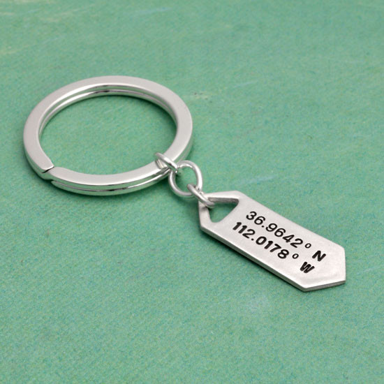 Hand stamped coordinates latitude longitude silver key chain, shown from the side