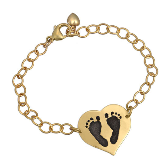 Your baby's actual footprints on custom gold bracelet, shown on white