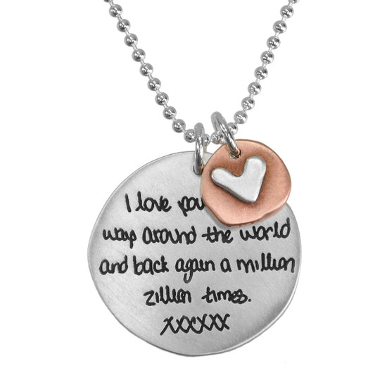 Custom silver handwriting necklace personalized with handwritten love note from spouse, with a copper disc with silver heart hung on a silver ball chain, shown close up on white