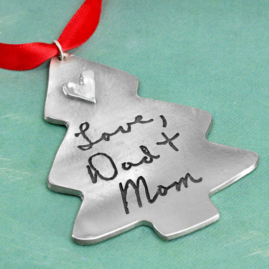 Personalized Christmas Tree Handwriting Ornament in fine pewter, customized with your loved one's handwritten note, shown on green