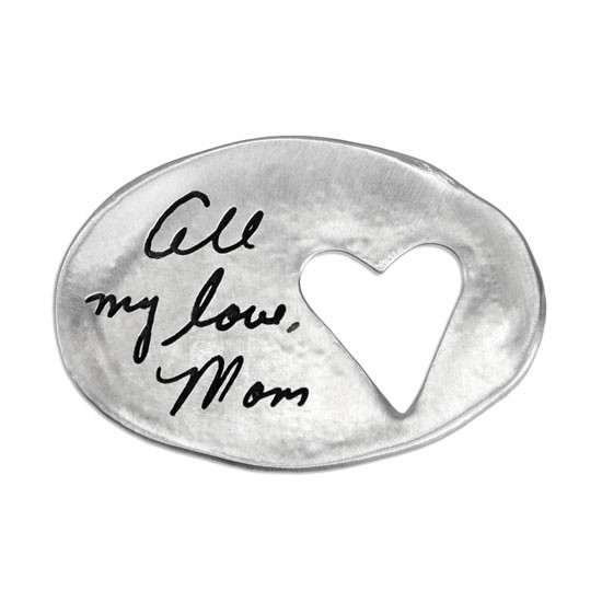 A custom Heart Cutout Handwriting Pocket Token, personalized with mom's signature, made from fine pewter,  and shown on white