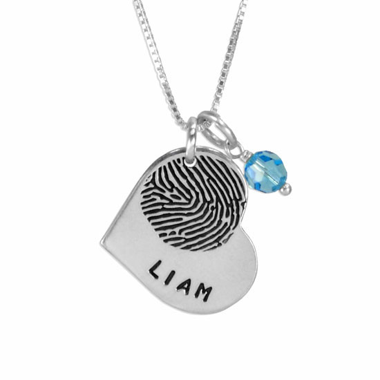 Personalized Silver Heart Fingerprint Necklace with Birthstone, customized with your loved one's actual fingerprint, & stamped with a name, shown close up on white