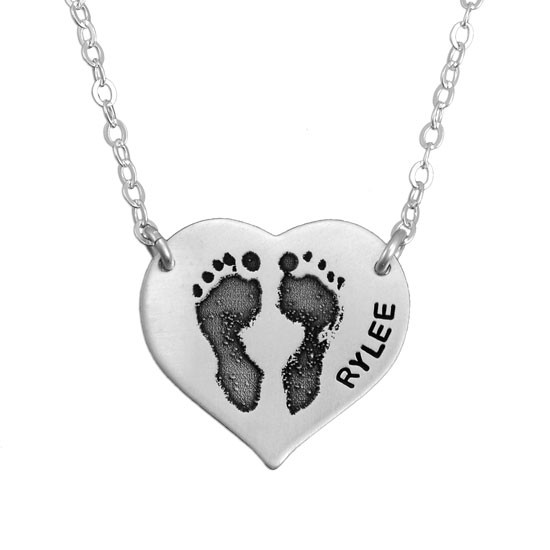 Sterling silver footprint necklace hanging from two holes in charm, with your child's actual footprints
