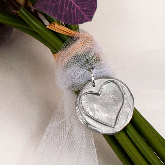 Custom hand stamped note on bouquet charm with heart