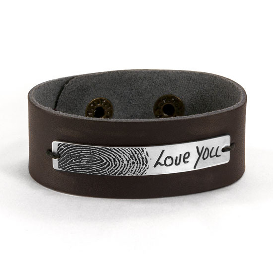 Close up image of custom memorial fingerprint & handwriting leather bracelet, with engraved silver plate