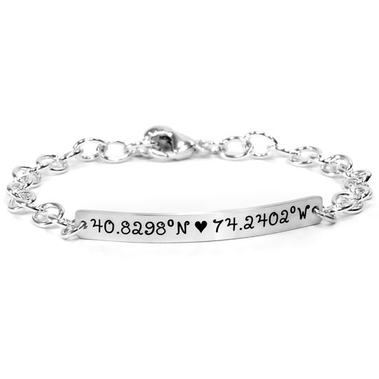 Silver personalized hand stamped coordinates bracelet, shown on white