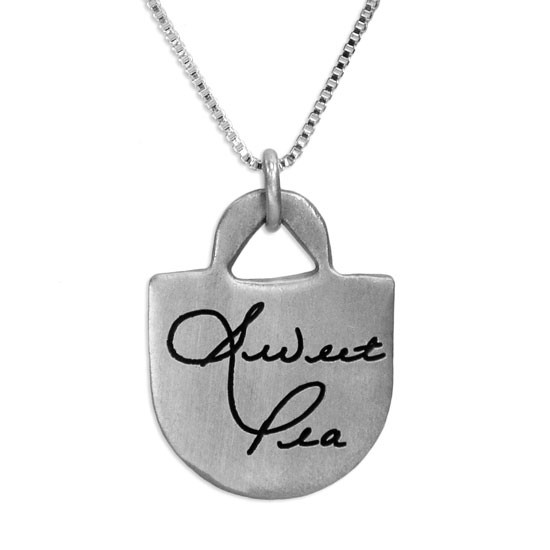 Custom sterling silver Love Tote Handwriting Necklace, personalized with your loved one's actual handwriting, shown close up on white