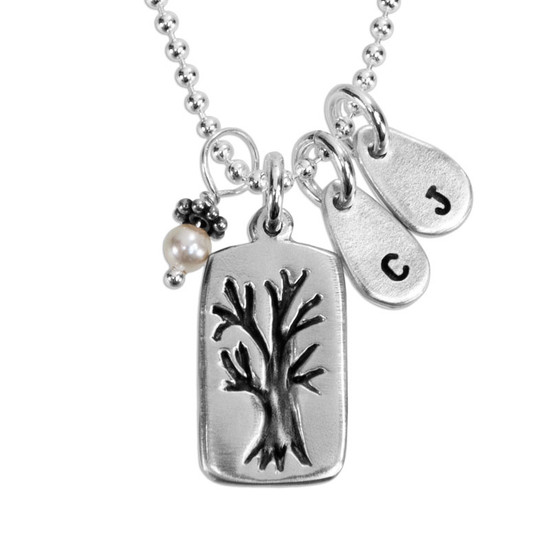 Custom fine silver Family Tree necklace, personalized with hand stamped kids' initials, hung with pearl charm, shown close up on white