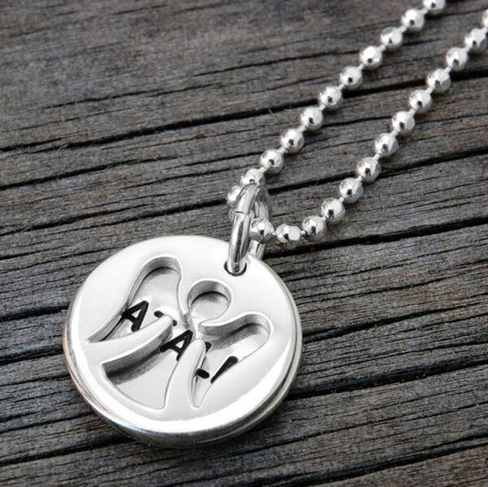 Custom Angel Charm and Name Disc Necklace, personalized with hand stamped name, shown from the side