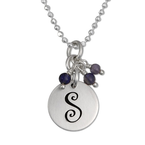 Curly initial handstamped onto pendant