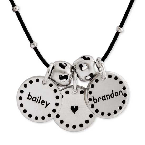 Dotted Border Sterling Silver Discs custom hand stamped with kids names and a heart, shown close up