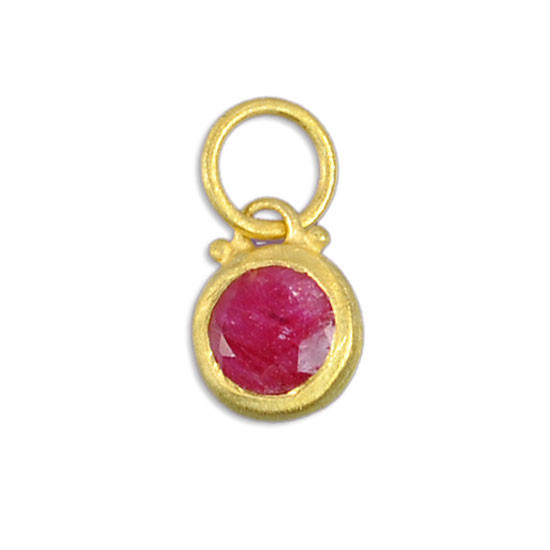Gold and ruby stone