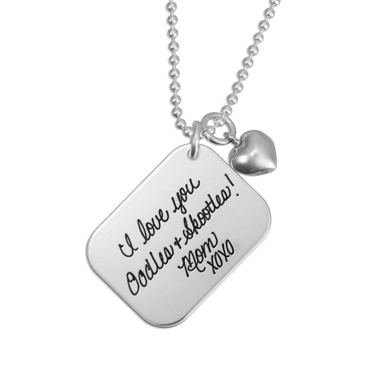 Custom Silver Love Letter Handwriting Necklace, with a silver puffed heart charm, shown close up on white