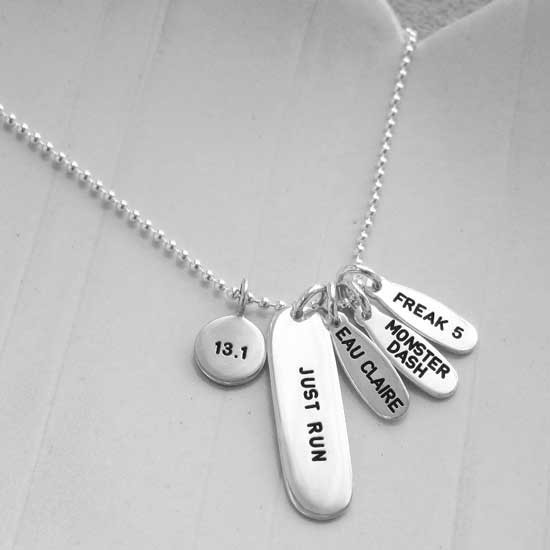 """Custom silver Marathon Necklace with charms showing marathons she's run, dates & distances, and a large silver tag stamped with, """"Just Run"""""""