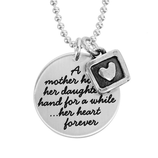 Hand stamped Mother Daughter Necklace in sterling silver, shown close up on white