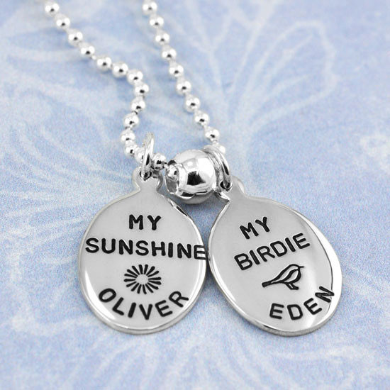 Sterling silver oval charms, personalized with hand stamped names Oliver & Eden, and a hand stamped sun & bird symbols