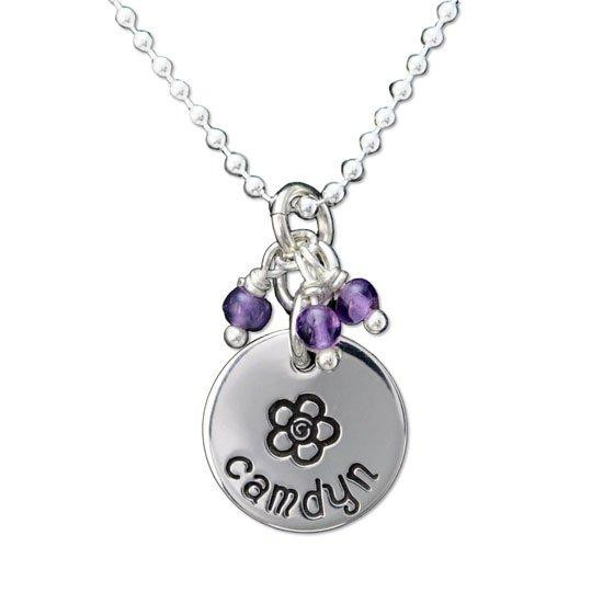 Custom sterling silver disc with stone cluster, personalized with hand stamped flower & child's name, and amethyst stones. Shown close up on white.