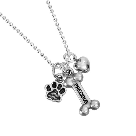 custom Sterling Silver Dog Bone Necklace, personalized with hand stamped dog name, silver Small Paw Charm, and silver puffed heart charm.