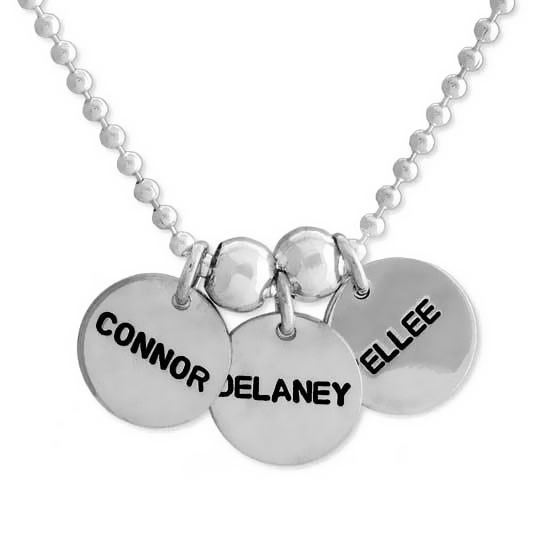 """Sterling Name Discs in 1/2"""", with kids names hand stamped on silver charms in Block Upper font, shown close up on white"""